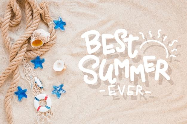 Letras de verão com conchas de areia e mar da praia Vetor grátis