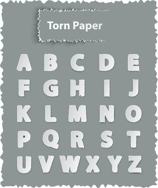 Letras do alfabeto em papel rasgado Vetor Premium