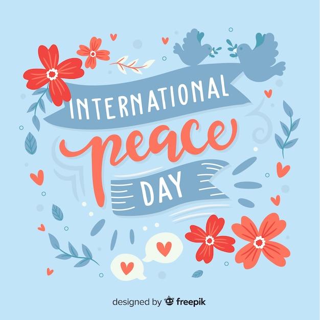 Letras do dia mundial da paz Vetor grátis