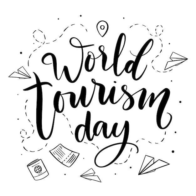 Letras do dia mundial do turismo com aviões de papel Vetor Premium