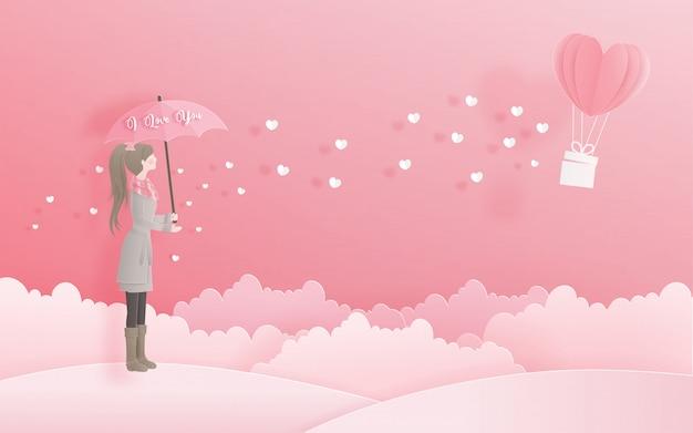 Linda menina segurando um guarda-chuva olhando para balão de coração, dia dos namorados e cartão Vetor Premium