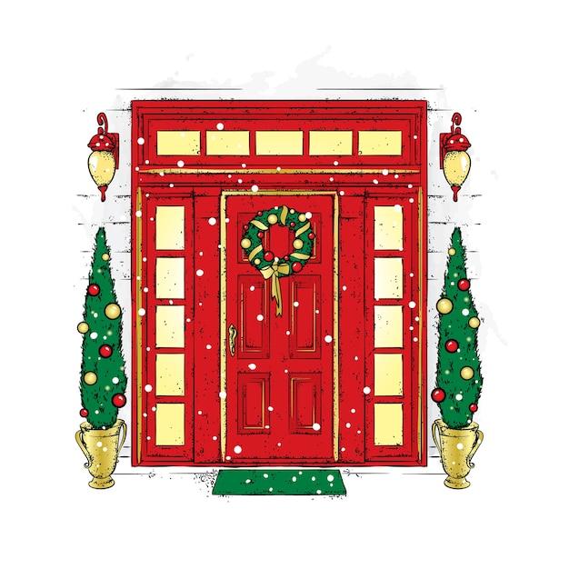 Linda porta com uma coroa de natal, lanternas e pinheiros nas laterais. Vetor Premium