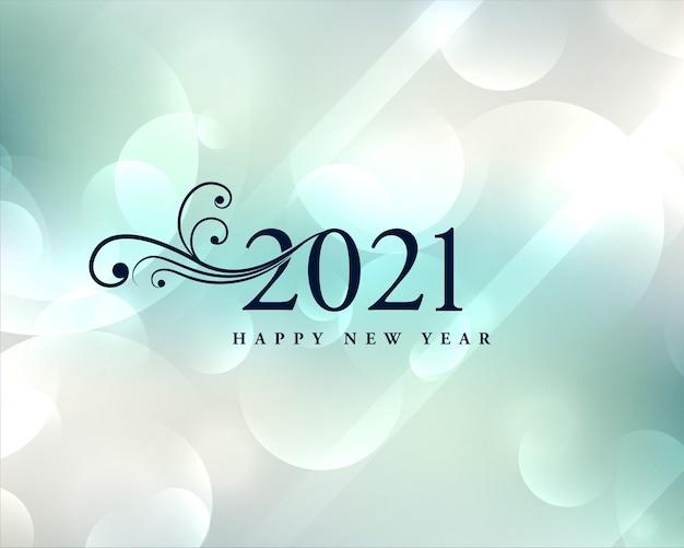 Lindo cartão de desejos de ano novo de 2021 com fundo bokeh Vetor grátis