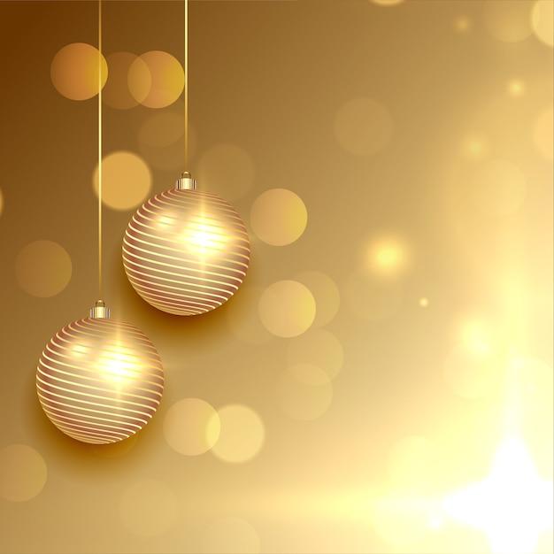 Lindo cartão dourado de natal com bolas Vetor grátis