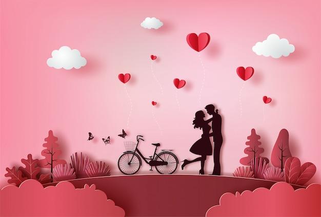 Lindo casal apaixonado, abraçando-se com muitos corações flutuando. Vetor Premium