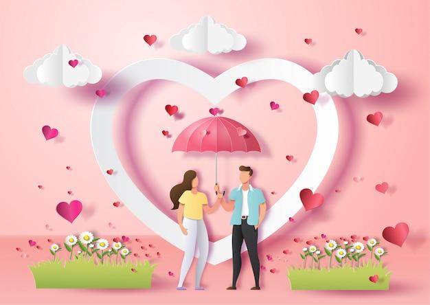 Lindo casal apaixonado, segurando o guarda-chuva com muitos corações. Vetor Premium