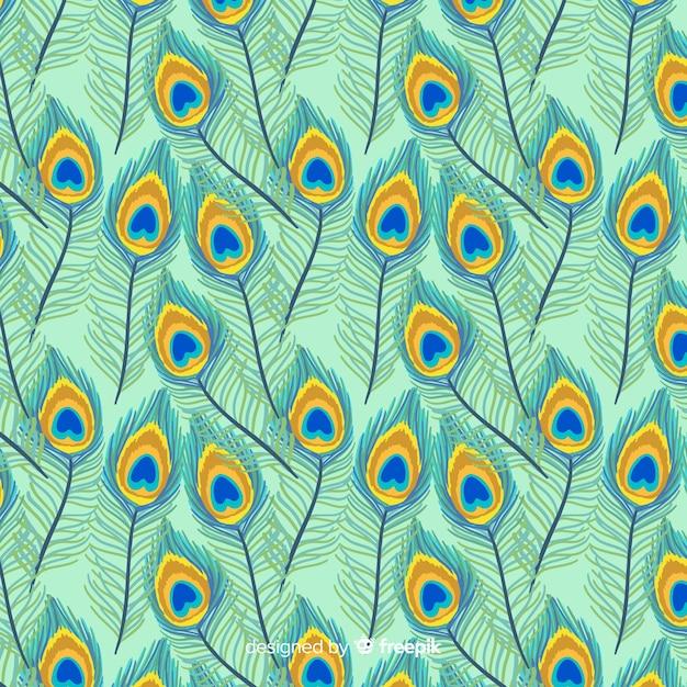 Lindo padrão de penas de pavão com design plano Vetor grátis