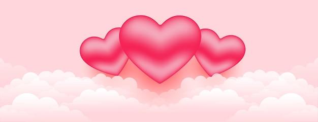Lindos corações 3d sobre a bandeira das nuvens Vetor grátis