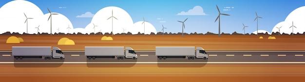 Linha de carga semi caminhão reboques dirigindo estrada sobre a paisagem de natureza horizontal banner Vetor Premium