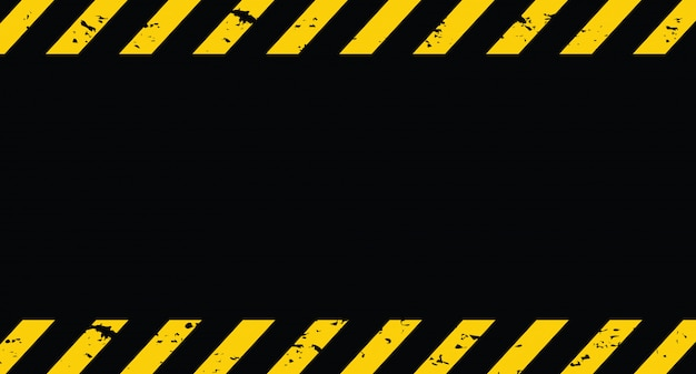 Linha preta e amarela listrada. sob o fundo do grunge de construção. Vetor Premium