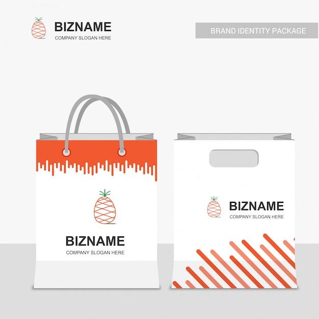 Logotipo da empresa de frutas e sacola de compras Vetor grátis