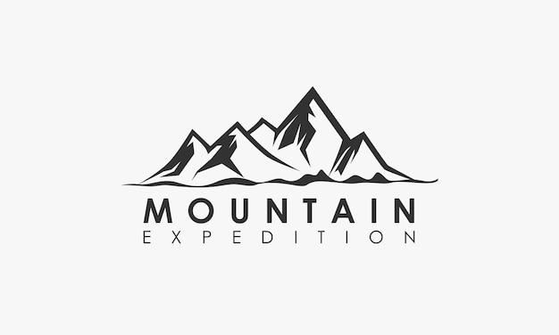 Logotipo de aventura de expedição de montanha Vetor Premium