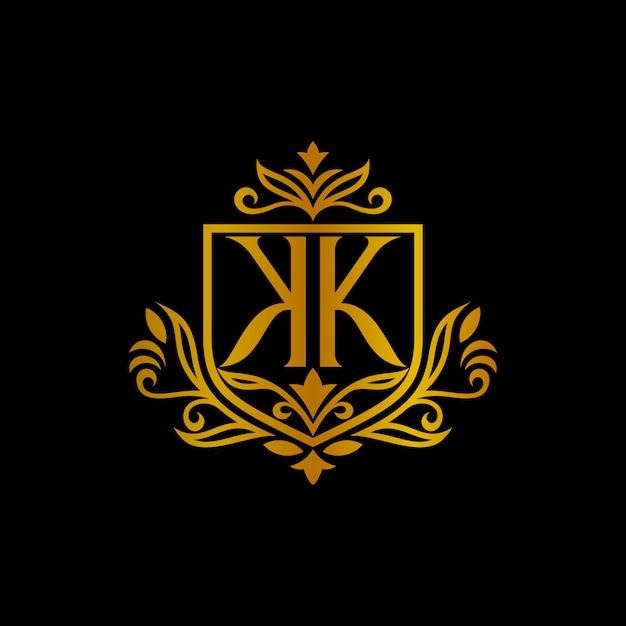 Logotipo de letra do monograma escudo kk com moldura entalhada de borda floral de folha Vetor Premium