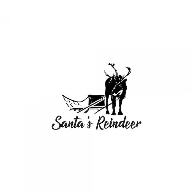 Logotipo de silhueta de renas do papai noel Vetor Premium