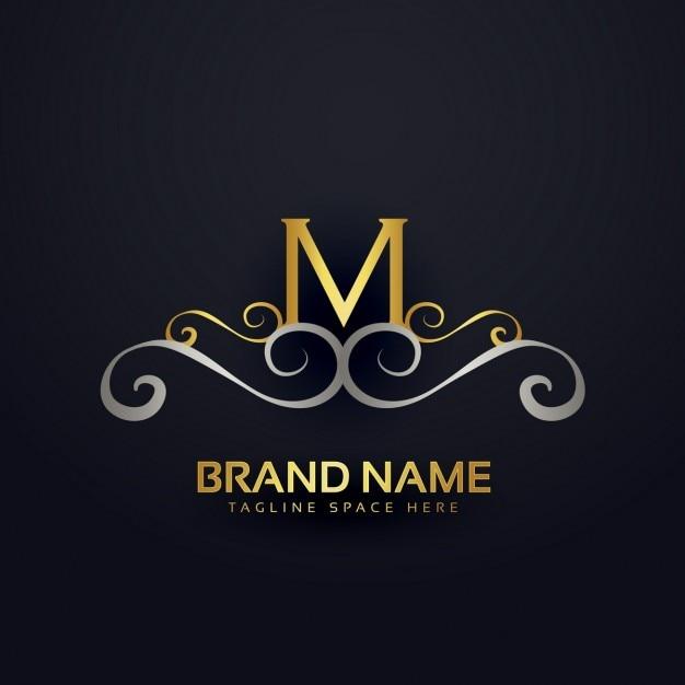 Logotipo m com ornamentos dourados Vetor grátis