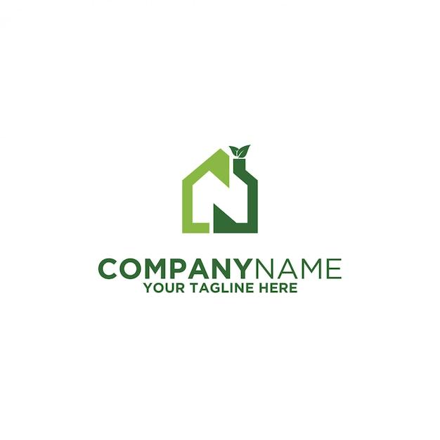 Logotipo verde em casa Vetor Premium