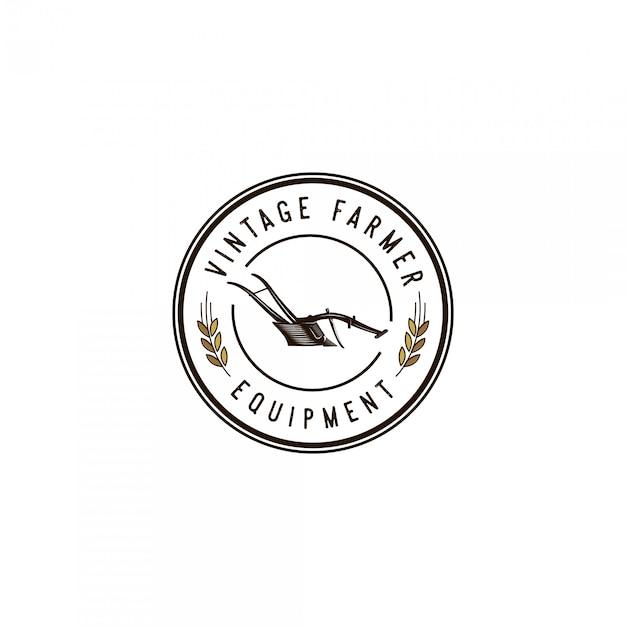 Logotipo vintage de equipamento de agricultor Vetor Premium