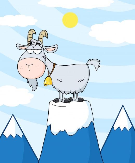 Longhorn de cabra no topo de um pico de montanha Vetor Premium