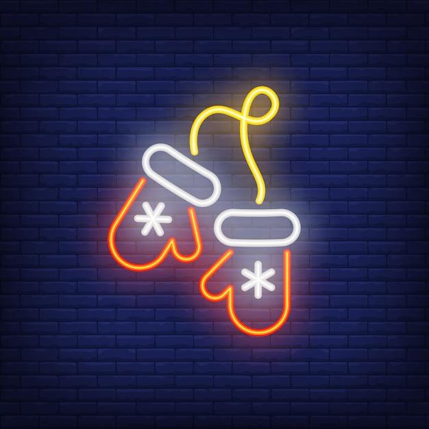 Luvas de natal néon com flocos de neve. noite brilhante elemento de propaganda. Vetor grátis
