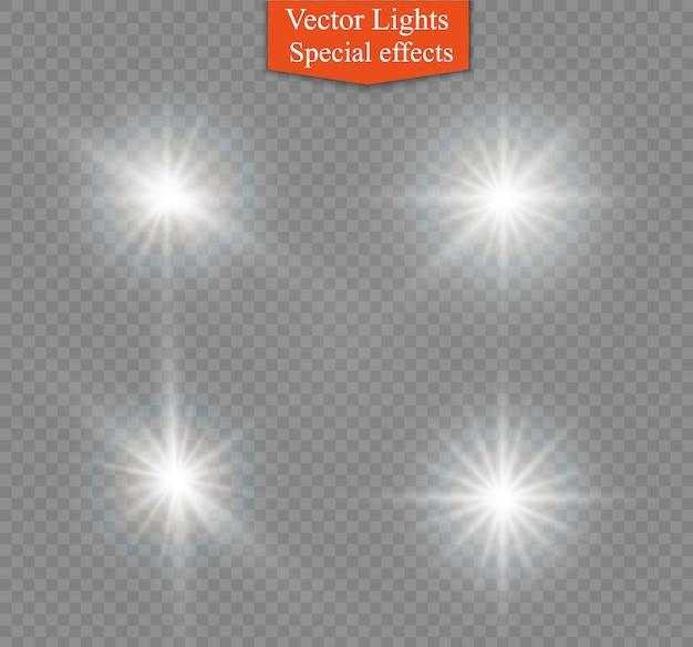 Luz branca brilhante explode em um fundo transparente. partículas de poeira mágica cintilante. estrela brilhante. sol brilhante e transparente, flash brilhante. brilhos. Vetor Premium