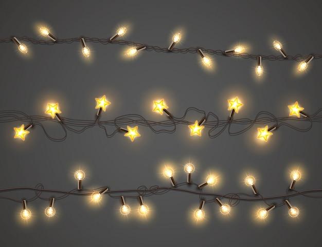 Luzes de natal, conjunto guirlanda realista Vetor Premium