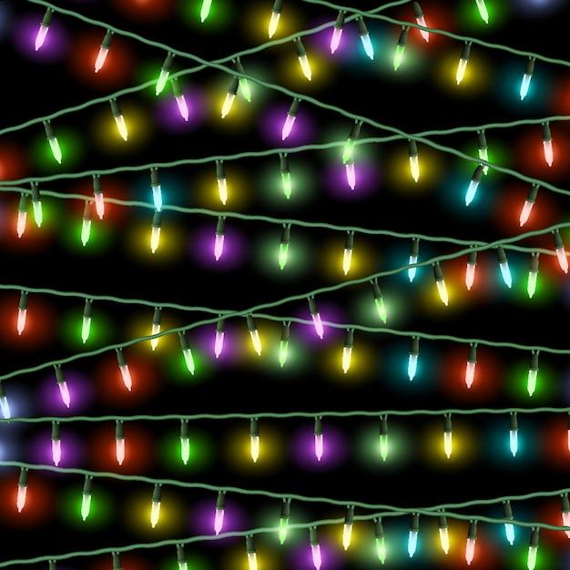 Luzes de natal de vetor em fundo preto Vetor Premium
