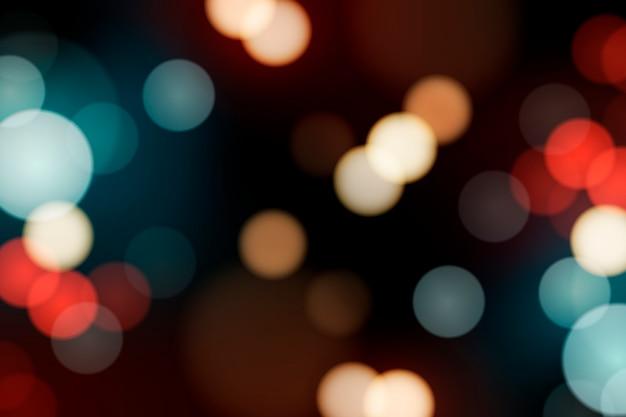Luzes desfocadas festivas Vetor grátis