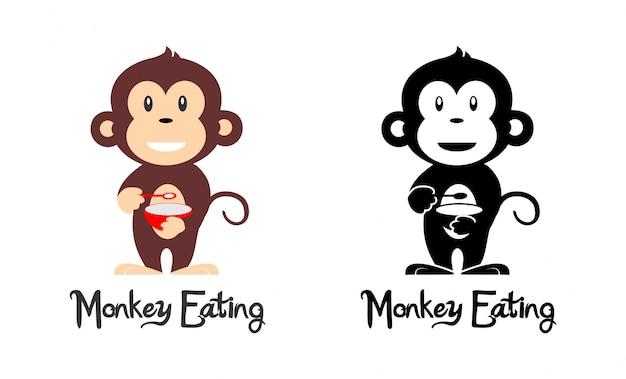 Macaco comendo Vetor Premium