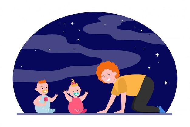 Mãe alegre, brincando com bebês gêmeos Vetor grátis