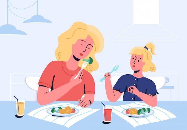 Mãe e filha aproveitando a refeição, consistindo de tomates, bloccoli e purê de batatas. a mãe mostra, por seu próprio exemplo, como é importante comer impotente. comedor exigente e problemas de mau apetite. Vetor Premium