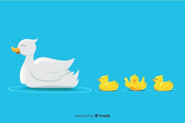 Mãe pato e seus pequenos patinhos na água Vetor grátis