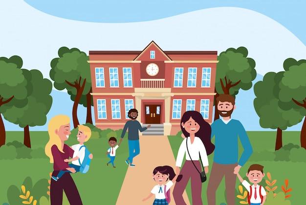 Mães e pai com seus filhos meninos e meninas na escola Vetor grátis