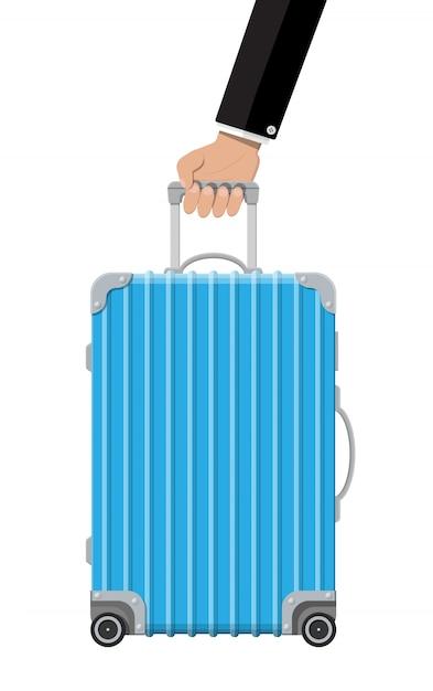 Mala de viagem azul na mão. caixa de plástico. Vetor Premium