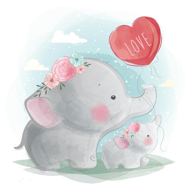 Mamãe e bebê elefante segurando um balão Vetor Premium