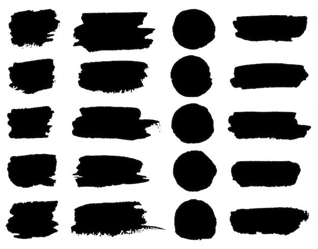 Manchas de pincel de tinta preta de vetor Vetor Premium