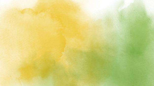 Mão abstrata pintada em aquarela amarela e verde para o fundo. Vetor Premium