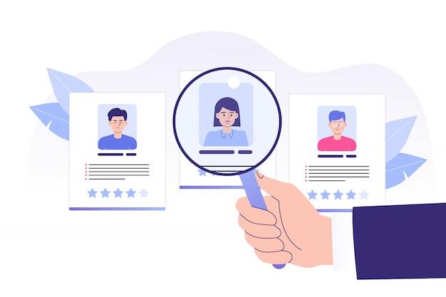 Mão apontando a grande lupa para a contratação de um candidato perfeito Vetor Premium
