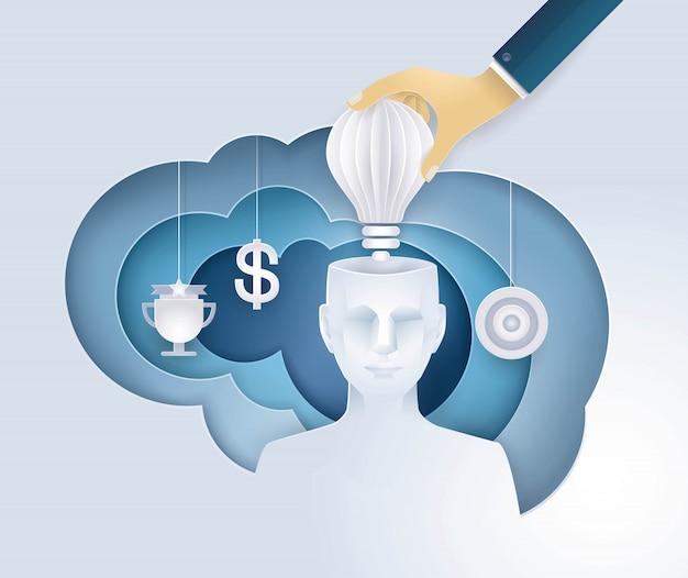 Mão, colocando uma lâmpada na cabeça humana, ter uma ideia, dando uma motivação, idéias criativas Vetor Premium