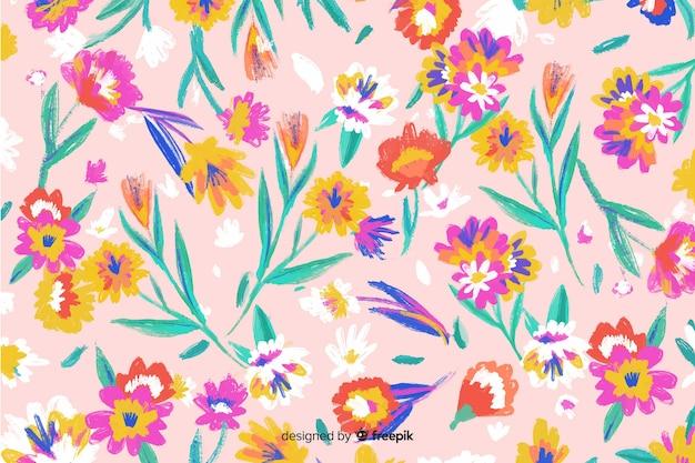 Mão colorido pintado fundo de flores Vetor grátis