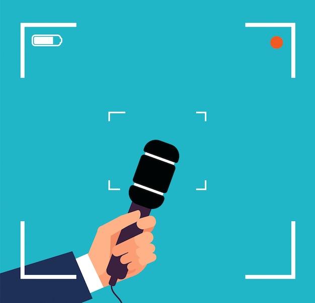 Mão com microfone. focus tv entrevista, transmissão de notícias ao vivo com visor e microfone Vetor Premium