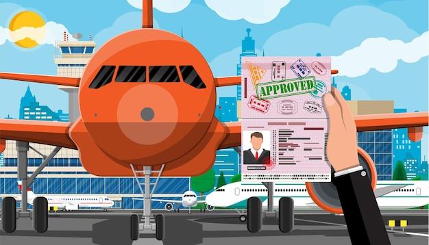 Mão com passaporte com ilustração de visto Vetor Premium