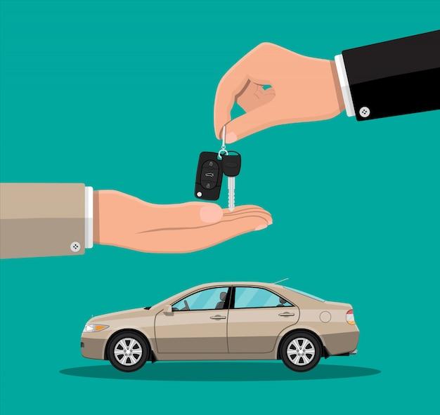 Mão dá as chaves do carro para outra mão Vetor Premium