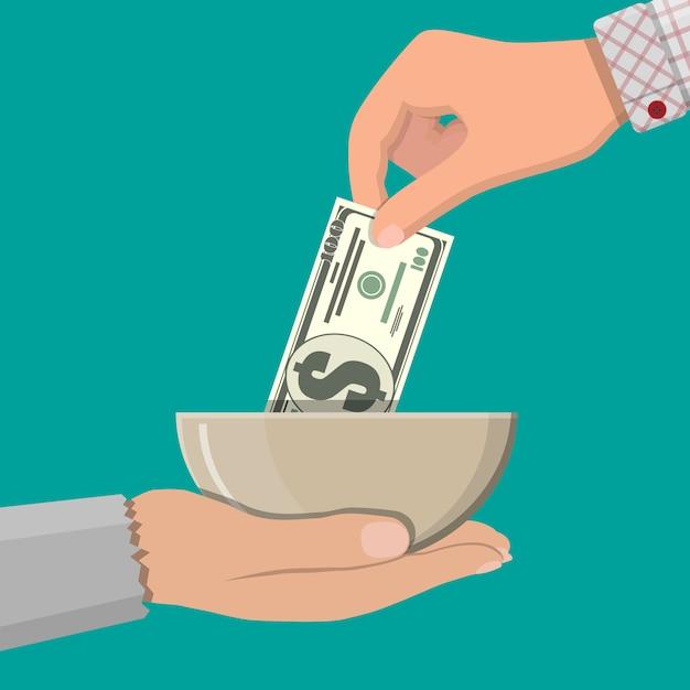 Mão dando moedas de ouro para outra mão Vetor Premium