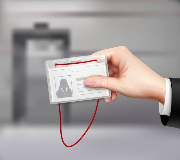 Mão de cartão de identificação comercial realista Vetor grátis