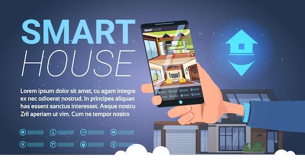 Mão de casa inteligente segurando o smartphone com aplicação de controle, moderna tecnologia de automação residencial Vetor Premium