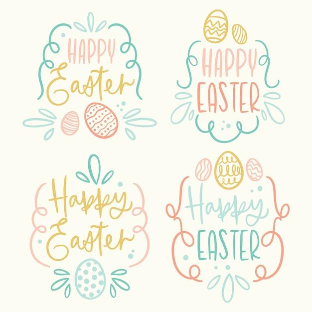 Mão de distintivo de dia de páscoa desenhada com ovos e letras Vetor grátis