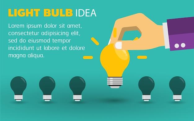 Mão de empresário dando lâmpada. conceito de idéia. Vetor Premium