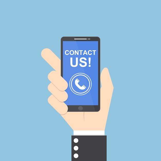 Mão de empresário segurando smartphone com entre em contato conosco texto Vetor Premium