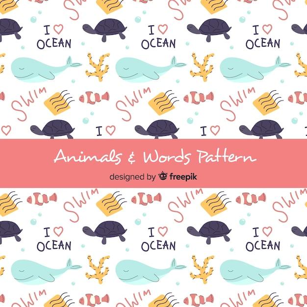 Mão desenhada animais marinhos e padrão de palavras Vetor grátis