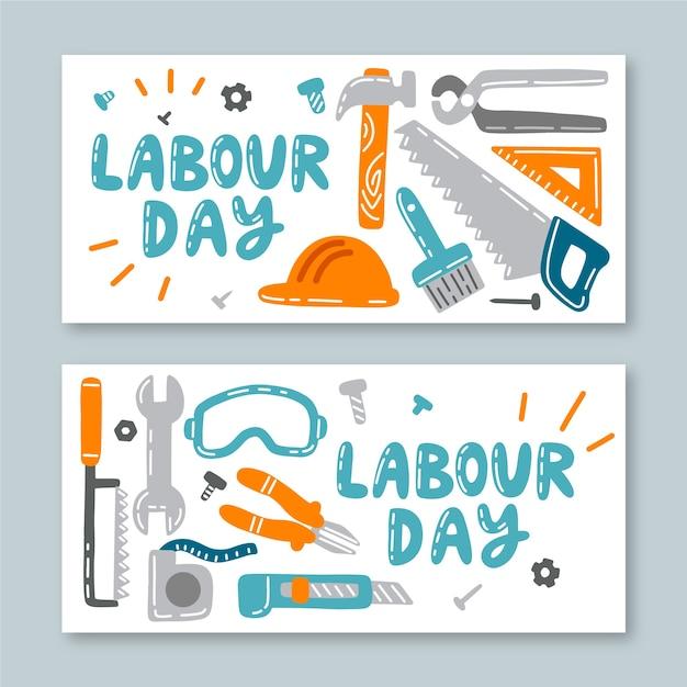 Mão desenhada banners do dia do trabalho Vetor grátis